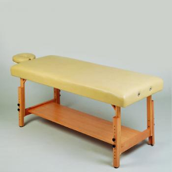 An examination and treatment bed with adjustable height